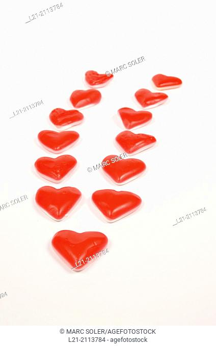 Candy red hearts on white background