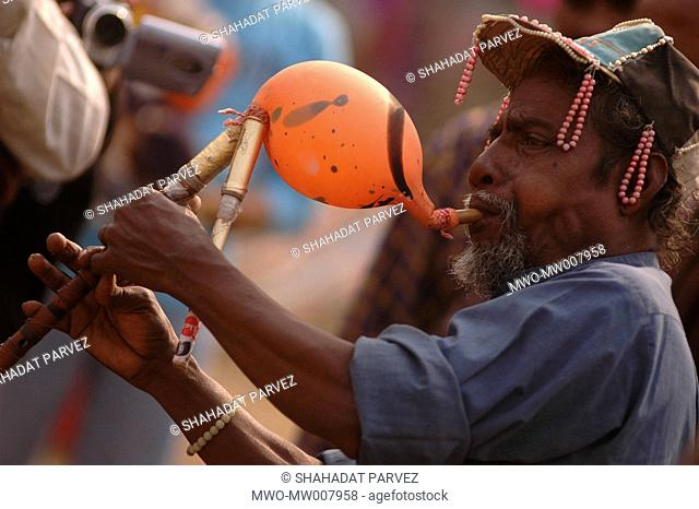 Portrait of a flute player at the Kite festival in Dhaka University, Bangladesh January 15, 2006