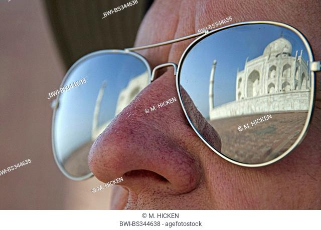 reflection of taj mahal in tourist's sunglasses,agra,india, India
