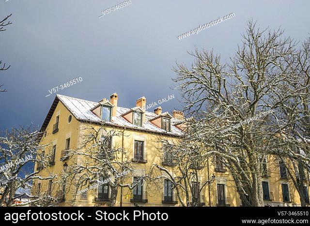 Snow covered houses. Plaza de España, La Granja de San Ildefonso, Segovia province, Castilla Leon, Spain