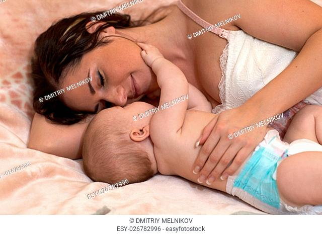 Mother and her sweet baby in the room at home. Happy family