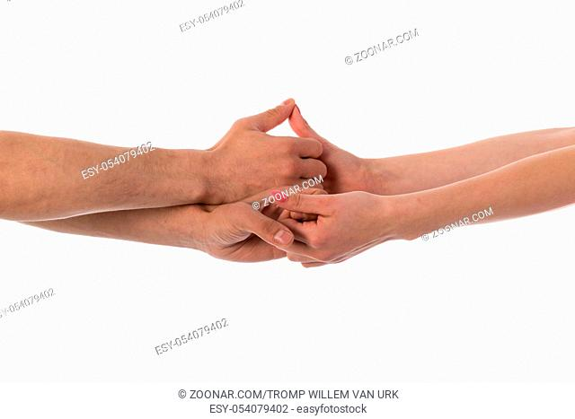 Four hands holding each other isolated over white