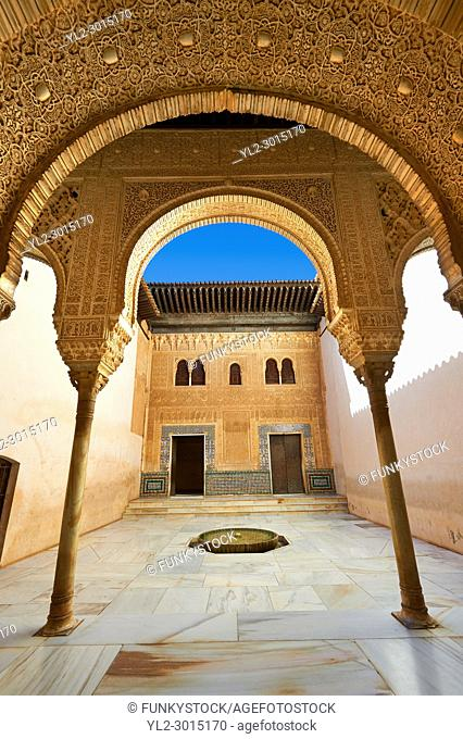 Arabesque Moorish architecture of an inner courtyard of the Palacios Nazaries, Alhambra. Granada, Andalusia, Spain