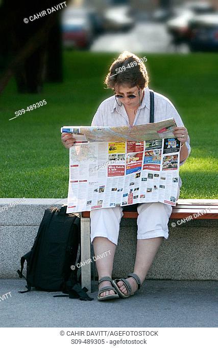 A lost tourist consults her map at Schwarzenberg Platz, in Vienna, Austria