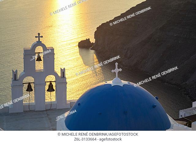 Blue Dome church and famous three bells with cross and steeple in Fira, Thira, Santorini Greece