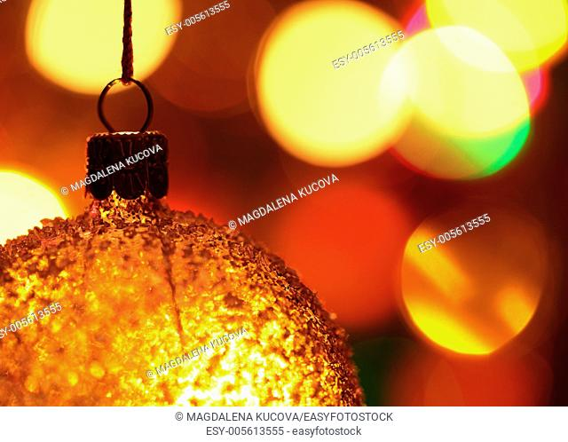 Close-up of Christmas ornament and defocused Christmas lights