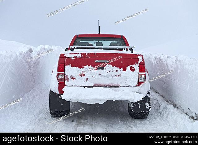 customised pick up truck driving through deep snow in north Iceland