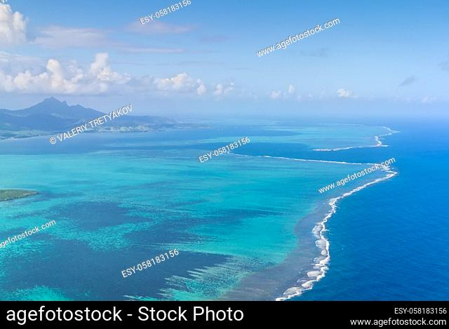 Aerial picture of the southeast, south east coast of Mauritius Island. Beautiful lagoon and reef barrier of Mauritius Island shot from above