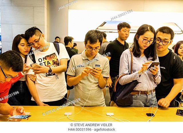 China, Hong Kong, Causeway Bay, Apple Store, Customers Looking at iPhones