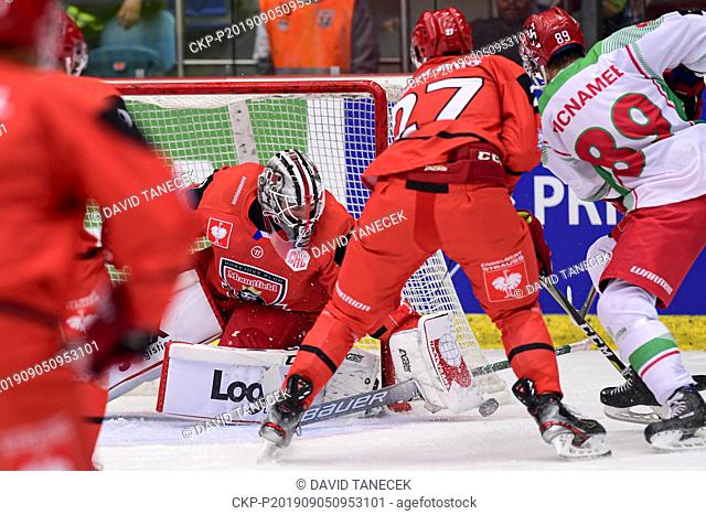 From left hockey players goalie MAREK MAZANEC, OSKARS CIBULSKIS both of Hradec Kralove, MIKE MCNAMEE of Cardiff in action during the Champions Hockey League H...