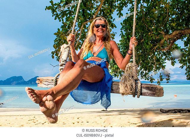 Woman on swing on beach, Koh Kradan, Thailand, Asia