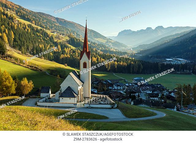Autumn morning at iconic alpine church in Winnebach, South Tyrol, Italy