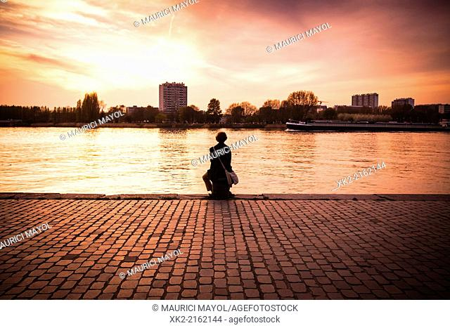 woman meditation in front of the river, Antwerp, Belgium