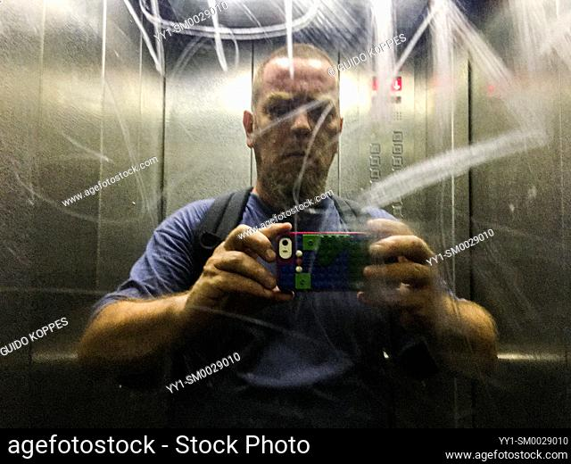 Berlin, Germany. Elevator Selfie of a mature adult male in an Elevator Mirror