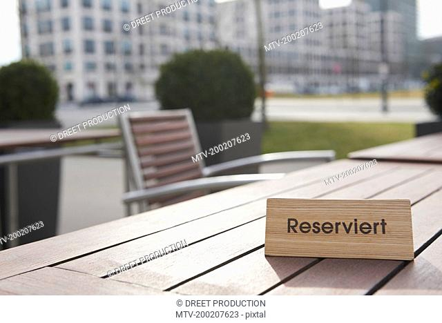 Reserved sign on the table in a sidewalk cafe, Munich, Bavaria, Germany