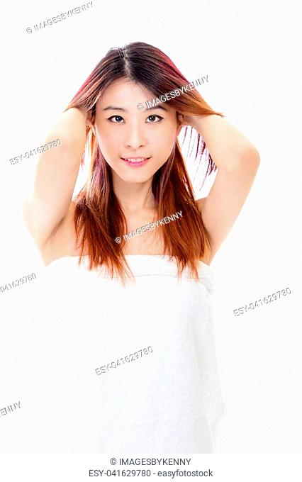 Chinese woman wearing a white towel isolated, beauty concept