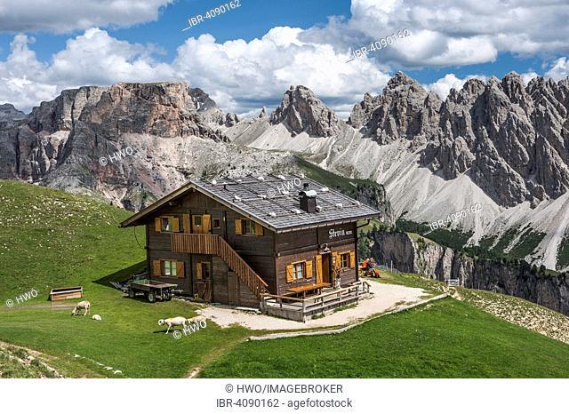 Steviahütte mountain inn, 2312m, Stevia massif, Puez group, Puez-Geisler Nature Park, Val Gardena Dolomites, at the back the Pizes de Cir mountain range