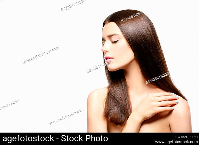 Beautiful young woman with healthy shiny straight hair. Beauty shot. Isolated over white background. Copy space