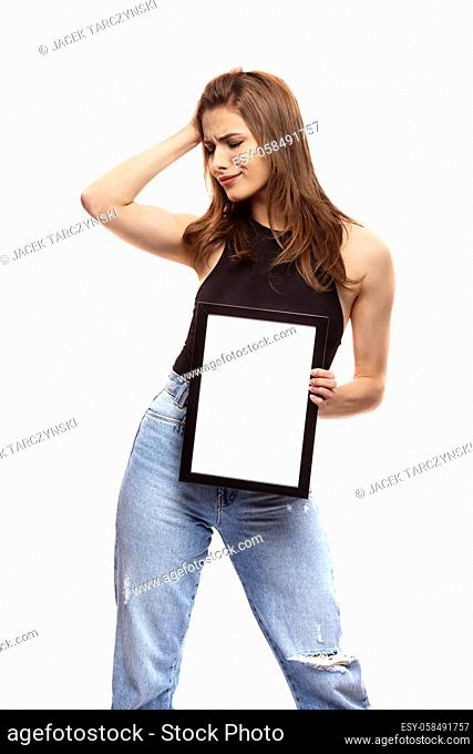 young woman thinking or wondering about something with frame for your text or image on white background