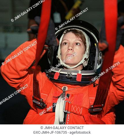 Astronaut Eileen M. Collins participates in a simulation of an emergency egress from a shuttle during preparations for her role as mission commander for next...