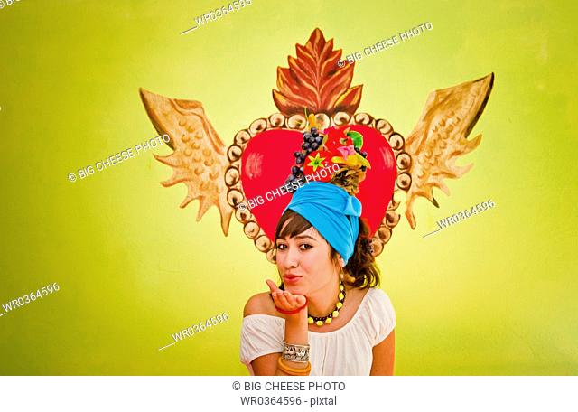young woman wearing fruit hat
