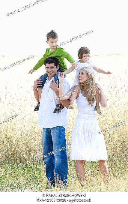 family walking on the field