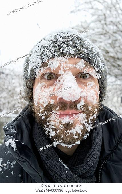 Portrait of man with snow in his face