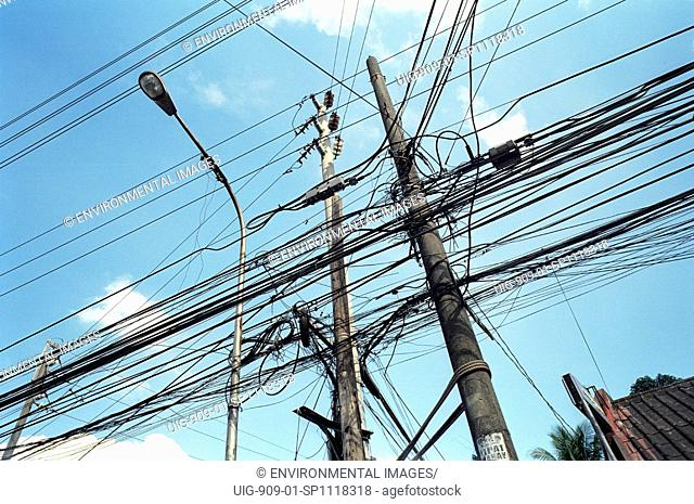 ELECTRICITY, PHILIPPINES. Manila. Electric cables. Householders and shopkeepers make illegal connections to electric cabling.
