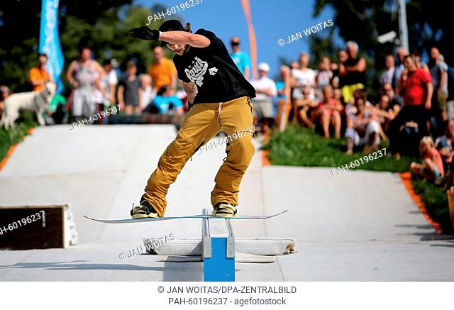 Marcel Wolfram traverses a rail with his snowboard in Augustusburg, Germany, 19 July 2015. More than 20 sportsman have come to the hillside to show of their...