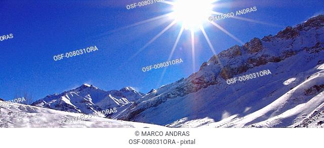 argentina mendoza solar rays falling down on the snow