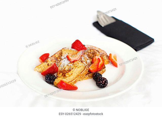 delicious french toast with berries served for breakfast in the hotel, in-room dining