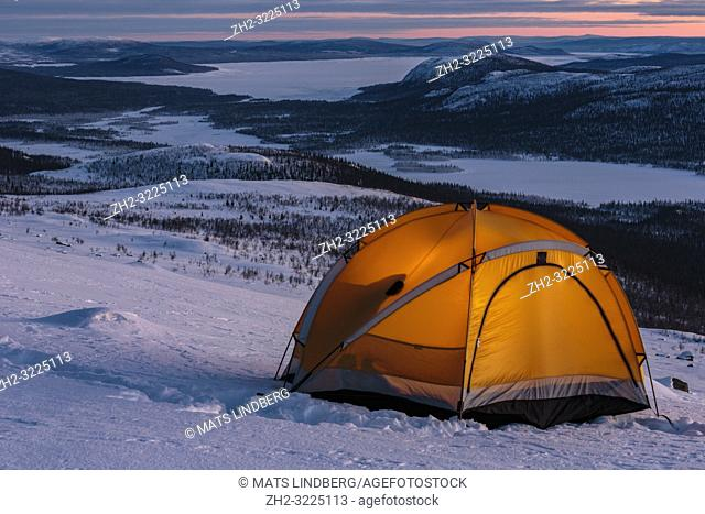 Tent on mountain with a wonderful view in winter in Swedish lapland, Sweden