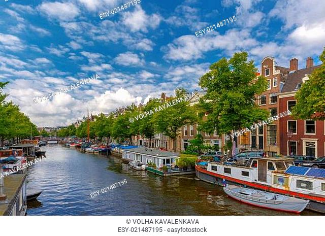 City view of Amsterdam canalsand typical houseboats, Holland, Ne