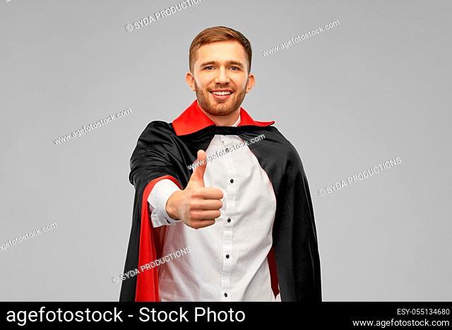 happy man in costume of vampire showing thumbs up