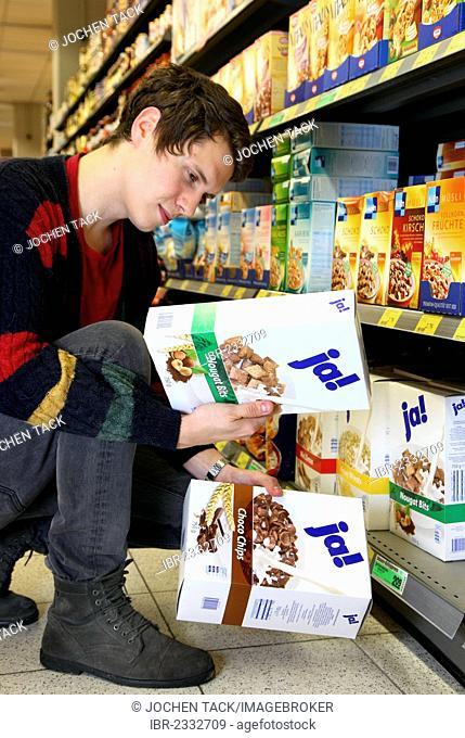 Man buying JA-brand Muesli, food hall, supermarket, Germany, Europe