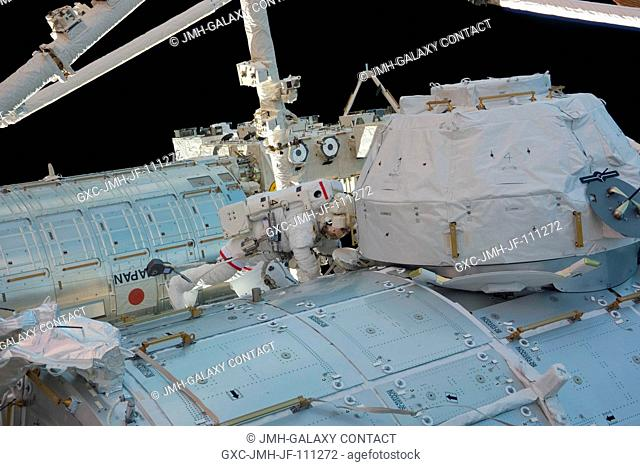 NASA astronaut Robert Behnken, STS-130 mission specialist, participates in the mission's third and final session of extravehicular activity (EVA) as...