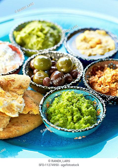 Dips: almond cream, hummus, olive tapenade, avocado cream, pea puree, raita