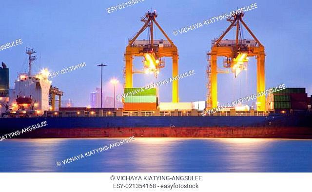 Cargo ship in port at dusk