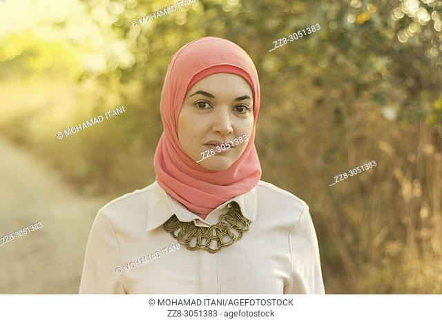 Beautiful Muslim woman standing outdoors