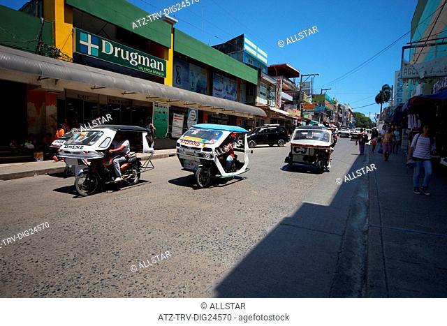 3 TRIKES ON VALENCIA STREET; PUERTO PRINCESA, PALAWAN, PHILIPPINES, ASIA; 22/04/2015