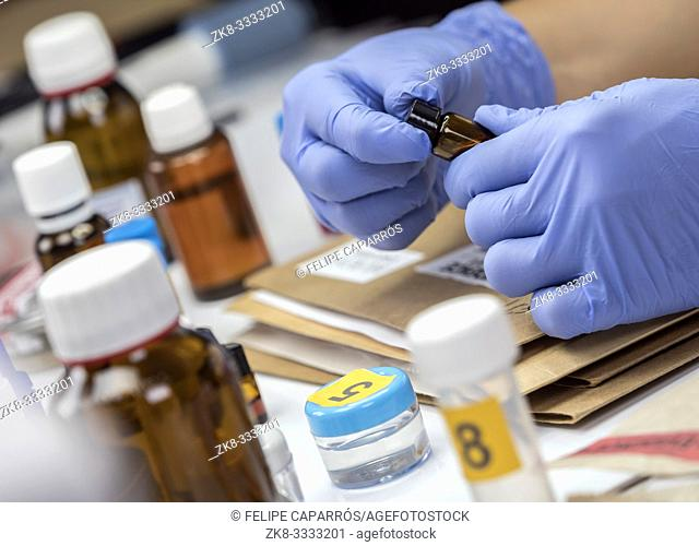 Scientific Police takes blood sample at Laboratorio forensic equipment, conceptual image
