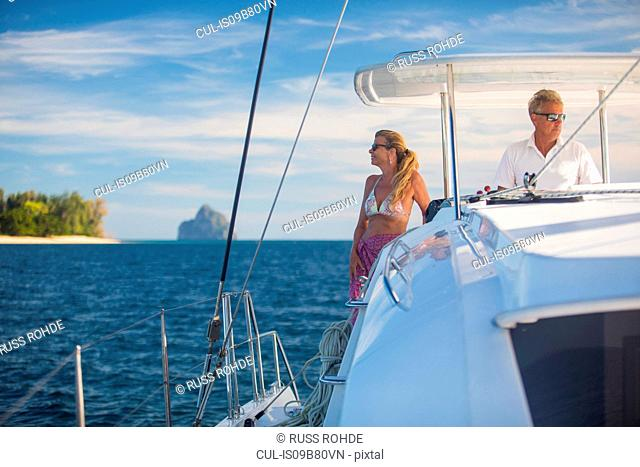 Couple relaxing on yacht, Koh Kradan, Thailand, Asia