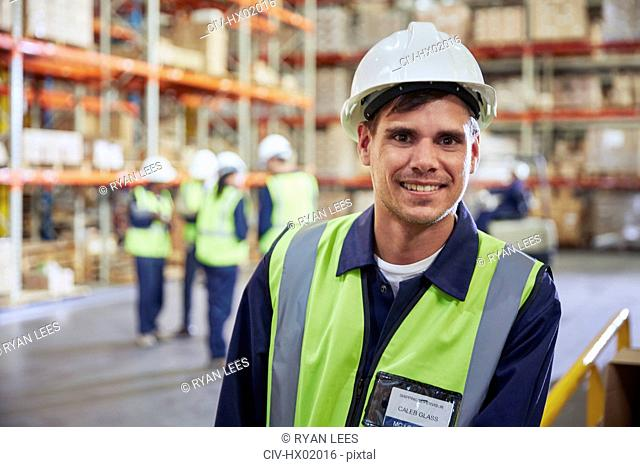 Portrait smiling worker in distribution warehouse
