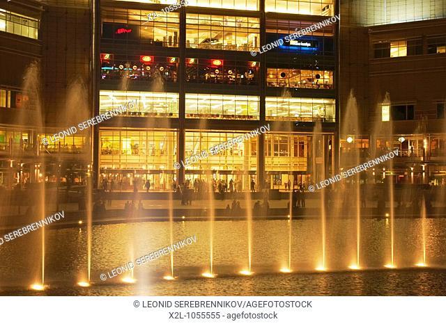 Illuminated fountains in front of Suria shopping centre  Kuala Lumpur, Malaysia