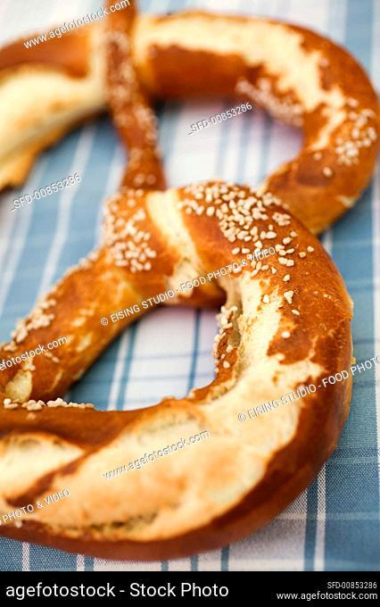 Soft pretzel on checked cloth