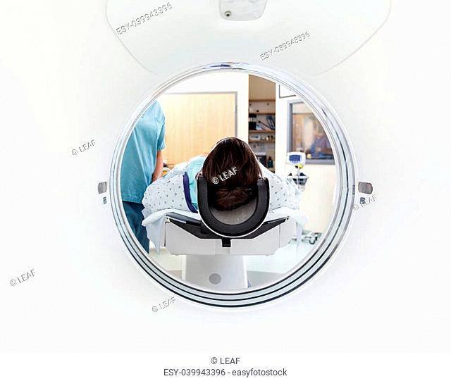 Female patient undergoing CT scan test in examination room