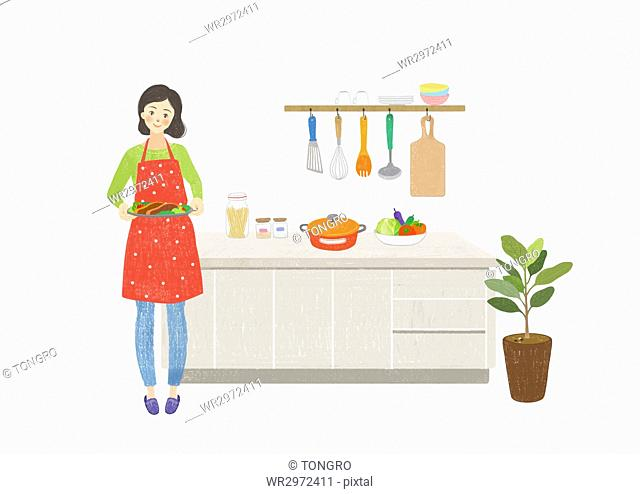 Smiling woman with food standing in kitchen