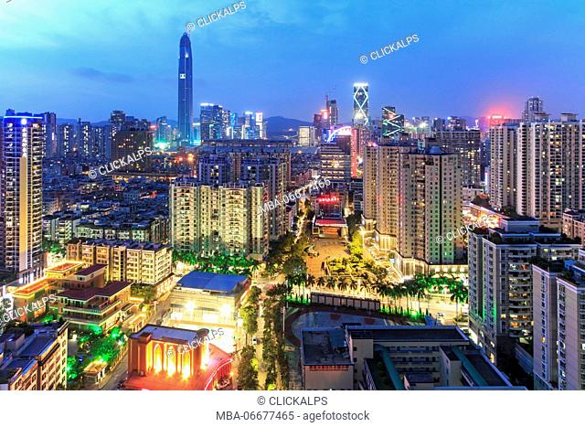 Shenzhen skyline at twilight with the tallest building of the city on background: the Ping An IFC, China