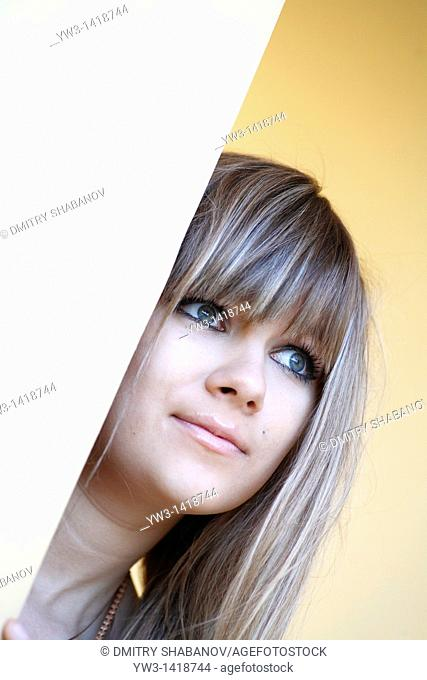 Closeup portrait of a beautiful 20-25 years woman outdoors with blank expression