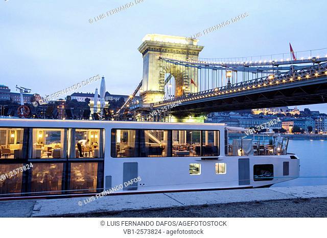 Cruise boat and Chain Bridge at dusk. Budapest, Hungary